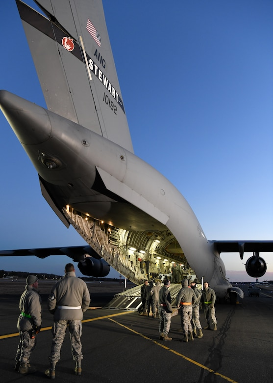 Airmen from the 104th Logistics Readiness Squadron helped unload pallets and equipment from a C-17 Globemaster III from the 105th Airlift Wing in Stewart, New York  Feb. 8, 2019, at Barnes Air National Guard Base, Massachusetts. The C-17 brought Airmen and equipment from Patrick Air Force Base in Florida back to the 104th Fighter Wing after a two week temporary duty assignment.  (U.S. Air National Guard photos by Airman Sara Kolinski)