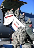 Airmen from the 104th Fighter Wing disembark from a KC-135 Stratotanker from the 128th Air Refueling Wing, Feb. 9, 2019, at Barnes Air National Guard Base, Massachusetts. The Airmen returned from a temporary duty assignment at Patrick Air Force Base where they trained with members of the 180th Fighter Wing. (U.S. Air National Guard photo by Airman 1st Class Randy Burlingame)