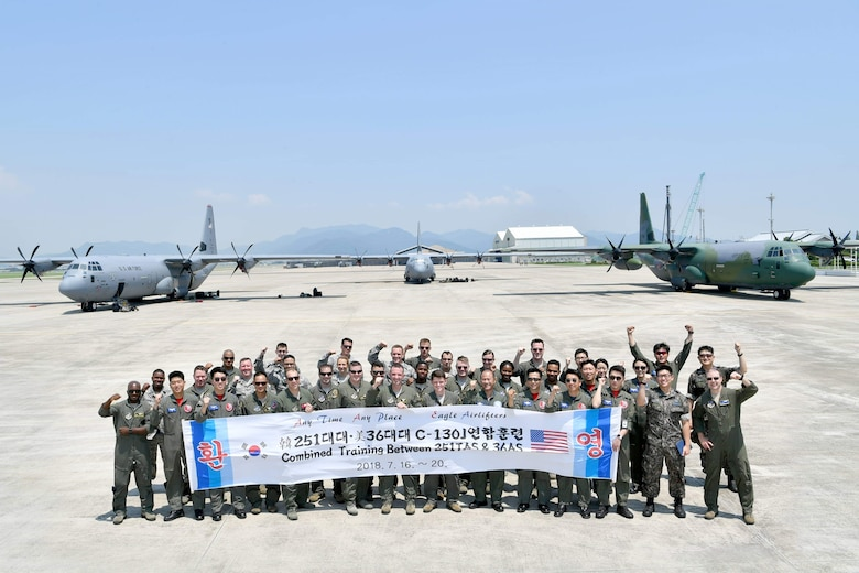 U.S. Airmen assigned to the 36th Tactical Airlift Squadron from Yokota Air Base, Japan, and Republic of Korea airmen with the 251st Airlift Squadron pose for a photo at Gimhae Air Base, ROK, July 2018. (Courtesy photo by Captain Jason Lim)