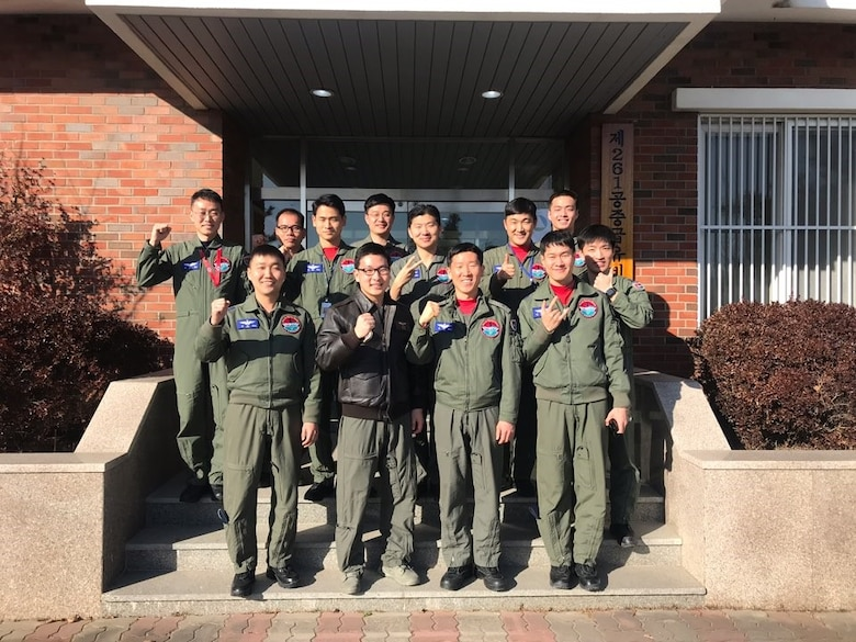 U.S. Air Force Capt. Jason Lim, front row, second from left, assigned to the 6th Air Refueling Squadron out of Travis Air Force Base, California, poses for a photo with Republic of Korea airmen assigned to the 261st Air Refueling Squadron at Gimhae Air Base, ROK, November 2018. (Courtesy photo by Captain Jason Lim)