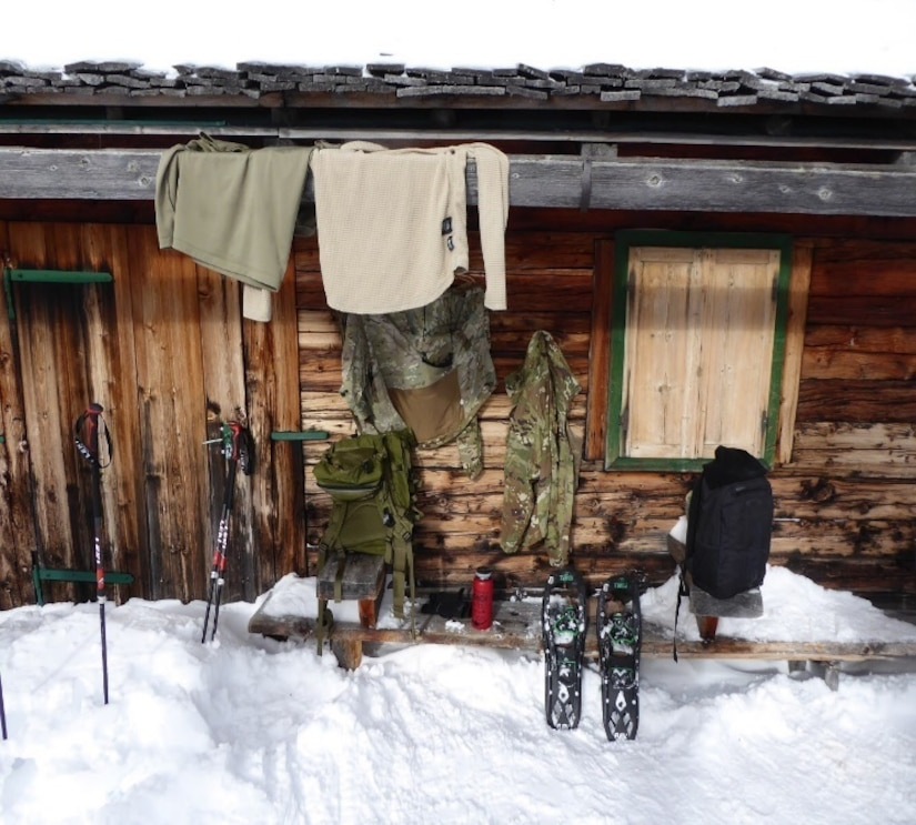 The 2500th Digital Liason Detachment dries out its gear after climbing to Refugio peak near Wiessenbach, Italy, Jan. 12 during the DLD's Jan 11-13 battle assembly.