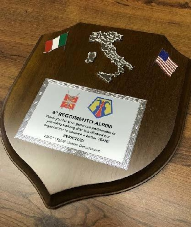 The 6th Alpini Regiment of the Italian army presented a plaque to the 2500th Digital Liason Detachment, Jan. 13 at the conclusion of the Detachment's three-day battle assembly, Jan. 11-13. The units climbed to Refuio peak near Wiessenbach, Italy.
