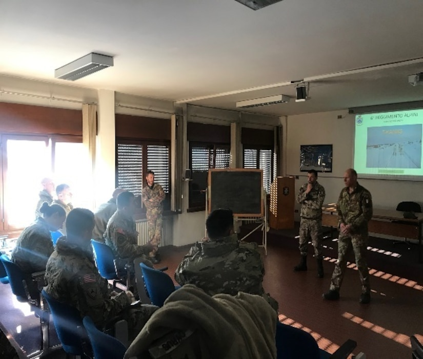 Team leaders from the 6th Alpini Regiment of the Italian army give classroom instruction to 22 members of the 2500th Digital Liason Detachment, Jan. 11, on cold weather survival and a training plan for the next day. The units climbed to Refugio peak near Wiessenbach, Italy during the DLD's Jan 11-13 battle assembly.
