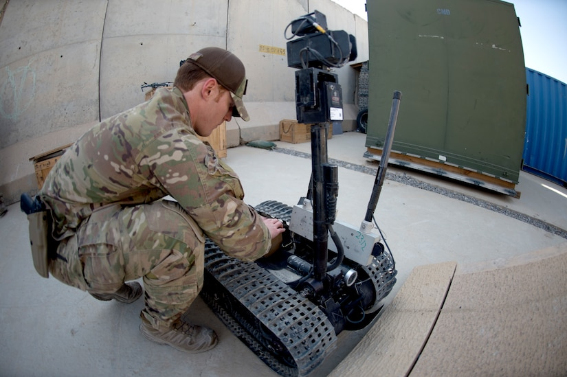 Staff Sgt. Joshua Holbrook, an explosive ordnance disposal technician assigned to the 753rd Ordnance Company displays the capability to use robots for reconnaissance Feb. 3, 2019.