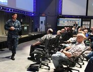 Rear Admiral Patrick Piercey, Commander Naval Surface Force Atlantic, discusses his thoughts on toughness and resiliency to the gathered innovators at a Tactical Advancement for the Next Generation (TANG) event focusing on Sailor toughness.