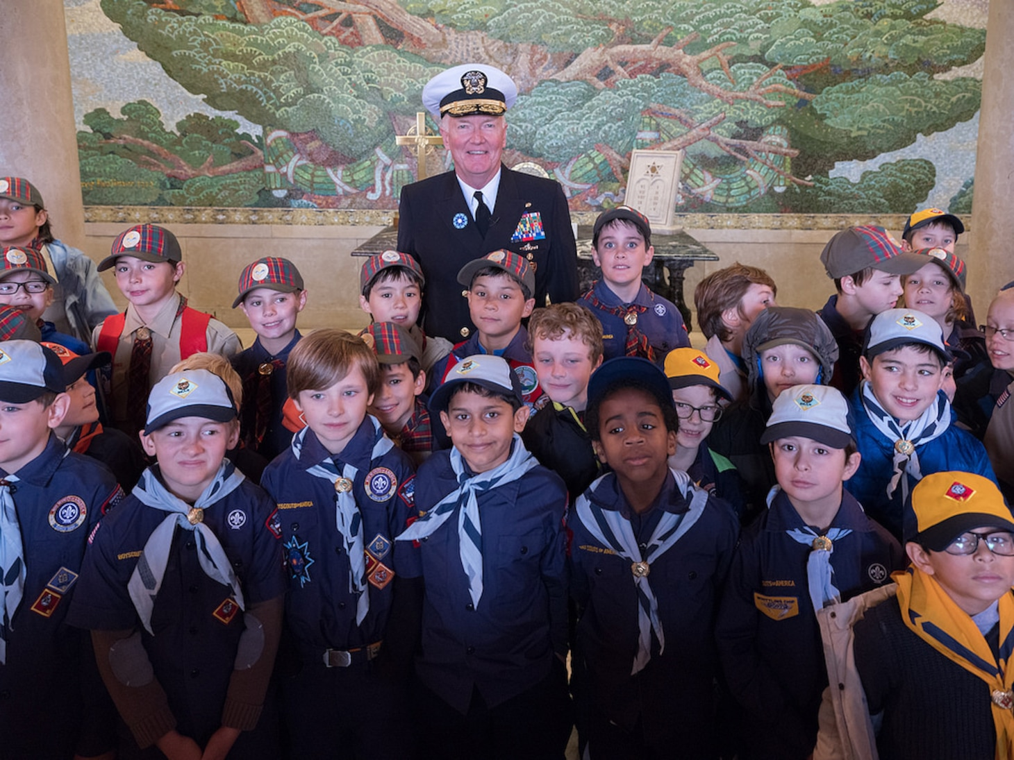 Adm. James Foggo III, commander, U.S. Naval Forces Europe-Africa, poses for a photo with American and French Boy and Girl Scouts during a ceremony at Suresnes American Cemetery celebrating Armistice and Veterans Day Nov. 11, 2017.