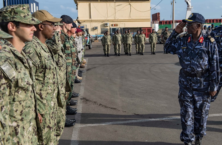 Sailors from the U.S., Indian, Comorian, Kenyan, Djiboutian and Somali navies along with U.S. Coast Guard sailors and Royal Netherlands Marines gather for the closing ceremony of exercise Cutlass Express 2019 in Djibouti, Feb. 6, 2019.