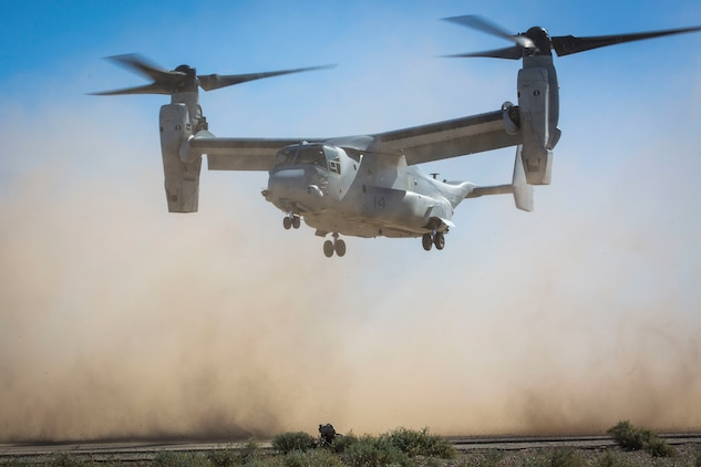 A U.S. Marine assigned to Marine Wing Support Squadron 371 (MWSS-371) sets up security as a MV-22B Osprey aircraft lands at AUX II, one of the training ranges that belongs to Marine Corps Air Station (MCAS) Yuma, Ariz., Jan. 22, 2019. During this portion of the training exercise, the bulk fuels specialists of MWSS-371 practiced setting up security for an MV-22B Osprey landing at AUX II. The MV-22B is a tiltrotor aircraft with both vertical takoff and landing (VTOL), and short takeoff and landing capabilities (STOL) and is the primary assault support aircraft for the U.S. Marine Corps. MCAS Yuma is a prime location to conduct military training with its variety of different training range; both foreign military units and all branches of the U.S. military that visit the air station utilize the ranges throughout the year. (U.S. Marine Corps photo by Cpl. Isaac D. Martinez)