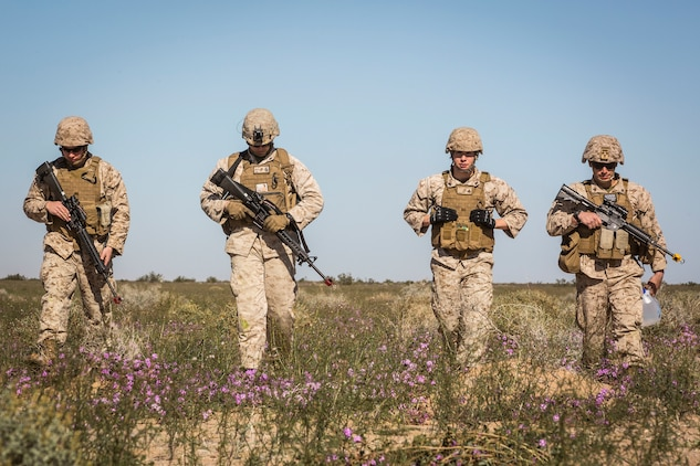 """U.S. Marines assigned to Marine Wing Support Squadron 371 (MWSS-371) walk towards a gathering point at AUX II, one of the ranges owned by Marine Corps Air Station (MCAS) Yuma, Ariz., Jan. 22, 2019. During this portion of the training exercise, the bulk fuels specialists of MWSS-371 practiced setting up security for an MV-22B Osprey landing at AUX II.The Marine Corps uses teams of four Marines, or a """"fire team,"""" each equipped with an team leader, automatic rifleman, assistant automatic rifleman, and a basic rifleman when conducting tactical operations.   MCAS Yuma is a prime location to conduct military training with its variety of different training range; both foreign military units and all branches of the U.S. military that visit the air station utilize the ranges throughout the year. (U.S. Marine Corps photo by Cpl. Isaac D. Martinez)"""