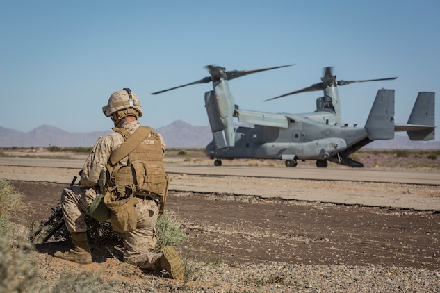 A U.S. Marine assigned to Marine Wing Support Squadron 371 (MWSS-371) provides security as a MV-22B Osprey sits on the landing strip at AUX II, one of the training ranges that belongs to Marine Corps Air Station Yuma, Ariz., Jan. 22, 2019. During this portion of the training exercise, the bulk fuels specialists of MWSS-371 practiced setting up security for an MV-22B Osprey landing at AUX II.