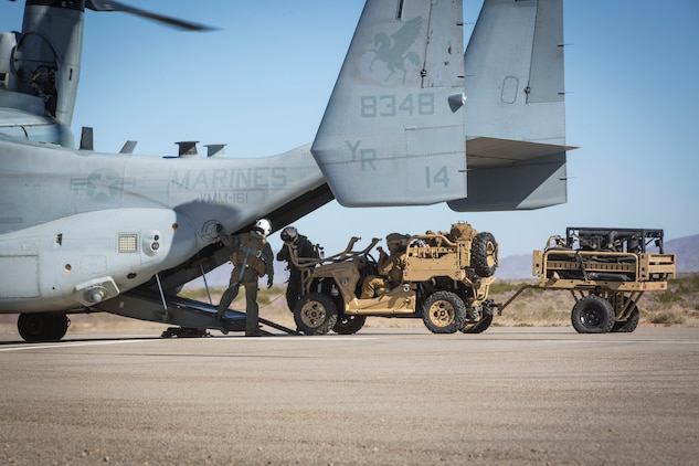 U.S. Marines assigned to Marine Wing Support Squadron 371 (MWSS-371) load a Polaris MRZR all-terrain vehicle onto a MV-22B Osprey at AUX II, one of the training ranges that belongs to Marine Corps Air Station Yuma, Ariz., Jan. 22, 2019.  The vehicle and bulk fuels specialists needed trasportation to Forward Armored Refueling Point -  LZ Star in order to set up light-weight camouflage screen systems (LCSS). The MV-22B is a tiltrotor aircraft with both vertical takoff and landing (VTOL), and short takeoff and landing capabilities (STOL) and is the primary assault support aircraft for the U.S. Marine Corps. Equipped with a turbo diesel engine and the ability to carry a payload of 1,000 lbs, the MRZR is a highly mobile vehicle that can handle supply transport missions, rapid personnel deployment, and more.