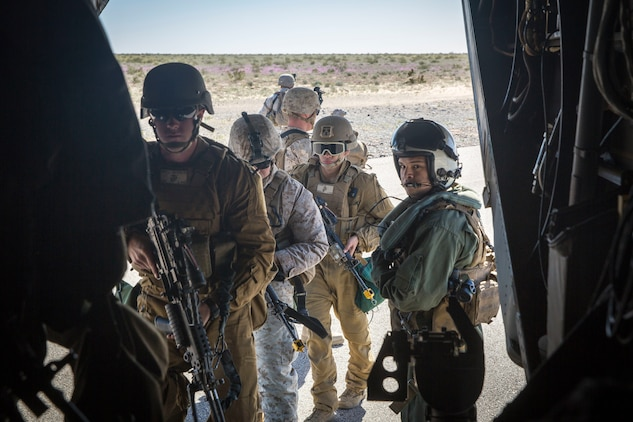 U.S. Marines assigned to Marine Wing Support Squadron 371 (MWSS-371) board a MV-22B Osprey at AUX II, one of the training ranges that belongs to Marine Corps Air Station Yuma, Ariz., Jan. 22, 2019. The bulk fuels specialists needed trasportation to Forward Armored Refueling Point -  LZ Star in order to set up light-weight camouflage screen systems (LCSS). The MV-22B is a tiltrotor aircraft with both vertical takoff and landing (VTOL), and short takeoff and landing capabilities (STOL) and is the primary assault support aircraft for the U.S. Marine Corps. MCAS Yuma is a prime location to conduct military training with its variety of different training range; both foreign military units and all branches of the U.S. military that visit the air station utilize the ranges throughout the year. (U.S. Marine Corps photo by Cpl. Isaac D. Martinez)