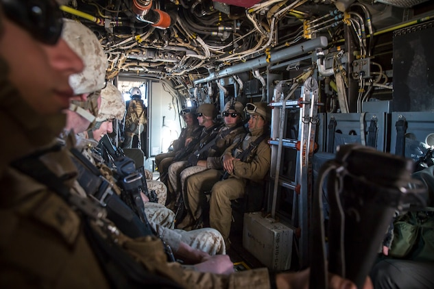 U.S. Marines assigned to Marine Wing Support Squadron 371 (MWSS-371) fly toward Forward Armored Refueling Point (FARP) - LZ Star in a MV-22B Osprey, Jan. 22, 2019. The bulk fuels specialists needed trasportation to FARP -  LZ Star in order to set up light-weight camouflage screen systems (LCSS). The MV-22B is a tiltrotor aircraft with both vertical takoff and landing (VTOL), and short takeoff and landing capabilities (STOL) and is the primary assault support aircraft for the U.S. Marine Corps. MCAS Yuma is a prime location to conduct military training with its variety of different training range; both foreign military units and all branches of the U.S. military that visit the air station utilize the ranges throughout the year. (U.S. Marine Corps photo by Cpl. Isaac D. Martinez)
