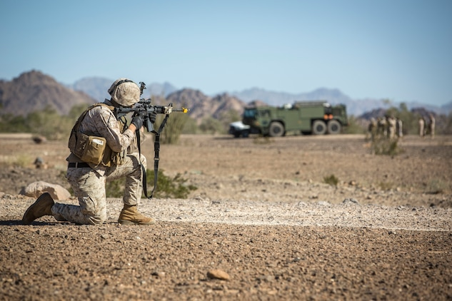 A U.S. Marine assigned to Marine Wing Support Squadron 371 (MWSS-371) provides security as a MV-22B Osprey leaves Forward Armored Refueling Point (FARP) - LZ Star, Jan. 22, 2019. During this portion of the training exercise, the bulk fuels specialists of MWSS-371 practiced setting up security for an MV-22B Osprey landing at AUX II. The MV-22B is a tiltrotor aircraft with both vertical takoff and landing (VTOL), and short takeoff and landing capabilities (STOL) and is the primary assault support aircraft for the U.S. Marine Corps. MCAS Yuma is a prime location to conduct military training with its variety of different training range; both foreign military units and all branches of the U.S. military that visit the air station utilize the ranges throughout the year. (U.S. Marine Corps photo by Cpl. Isaac D. Martinez)