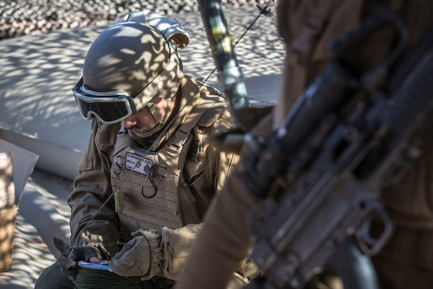 U.S. Marine Corps Sgt. Angel Manzanoramirez, a bulk fuels specialist assigned to Marine Wing Support Squadron 371 (MWSS-371), helps set up a light-weight camouflage screen system (LCSS) at Forward Armored Refueling Point -  LZ Star, Jan. 22, 2019. During this portion of their training exercise, the bulk fuels specialists practiced working together to put together a camouflaged camp at FARP - LZ Star. MCAS Yuma is a prime location to conduct military training with its variety of different training range; both foreign military units and all branches of the U.S. military that visit the air station utilize the ranges throughout the year. (U.S. Marine Corps photo by Cpl. Isaac D. Martinez)