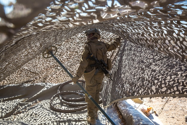 A U.S. Marine assigned to Marine Wing Support Squadron 371 (MWSS-371), helps set up a light-weight camouflage screen system (LCSS) at Forward Armored Refueling Point -  LZ Star, Jan. 22, 2019. During this portion of their training exercise, the bulk fuels specialists practiced working together to put together a camouflaged camp at FARP - LZ Star. MCAS Yuma is a prime location to conduct military training with its variety of different training range; both foreign military units and all branches of the U.S. military that visit the air station utilize the ranges throughout the year. (U.S. Marine Corps photo by Cpl. Isaac D. Martinez)
