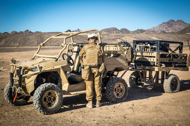 U.S. Marine Corps Sgt. Angel Manzanoramirez, a bulk fuels specialist assigned to Marine Wing Support Squadron 371 (MWSS-371), grabs a radio from a Polaris MRZR all-terrain vehicle at Forward Armored Refueling Point -  LZ Star, Jan. 22, 2019. During this portion of their training exercise, the bulk fuels specialists practiced working together to put together a camouflaged camp at FARP - LZ Star. Equipped with a turbo diesel engine and the ability to carry a payload of 1,000 lbs, the MRZR is a highly mobile vehicle that can handle supply transport missions, rapid personnel deployment, and more. MCAS Yuma is a prime location to conduct military training with its variety of different training range; both foreign military units and all branches of the U.S. military that visit the air station utilize the ranges throughout the year. (U.S. Marine Corps photo by Cpl. Isaac D. Martinez)