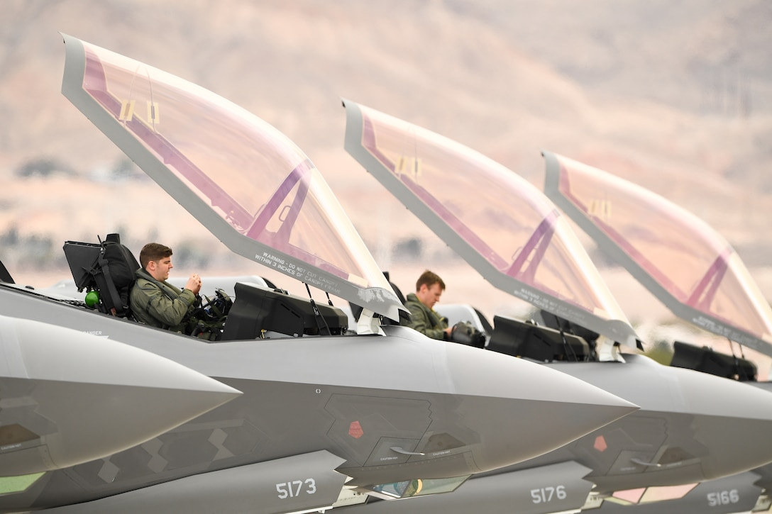 Pilots from the 388th Fighter Wing's 4th Fighter Sqaudron prepare for launch,