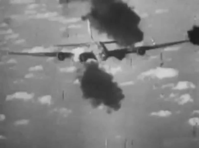 Photo taken by a German fighter during a head-on attack on an American B-17 Flying Fortress, possibly in 1943. The black smoke comes from hits made by the German fighter on the B-17. (Archive photo)