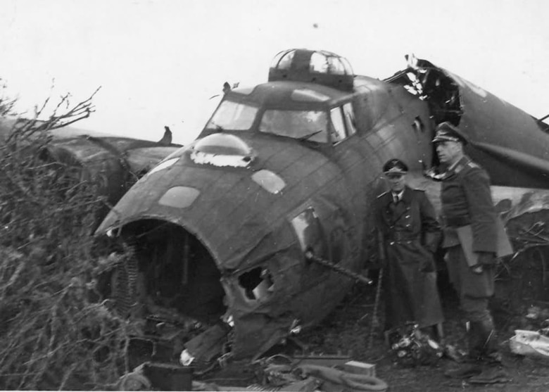 Several Luftwaffe officers inspect a crashed B-17 somewhere in Germany. Between August 1942 and May 8, 1945, Eighth Air Force flew 10,631 missions and lost 4,145 B-17s, each with a 10-man crew. (Archive photo)