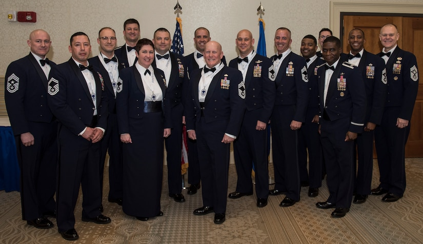 The new chief master sergeants and chief master sergeant selects stand with base leadership during an induction ceremony Feb. 9, 2019, at Joint Base Charleston, S.C.