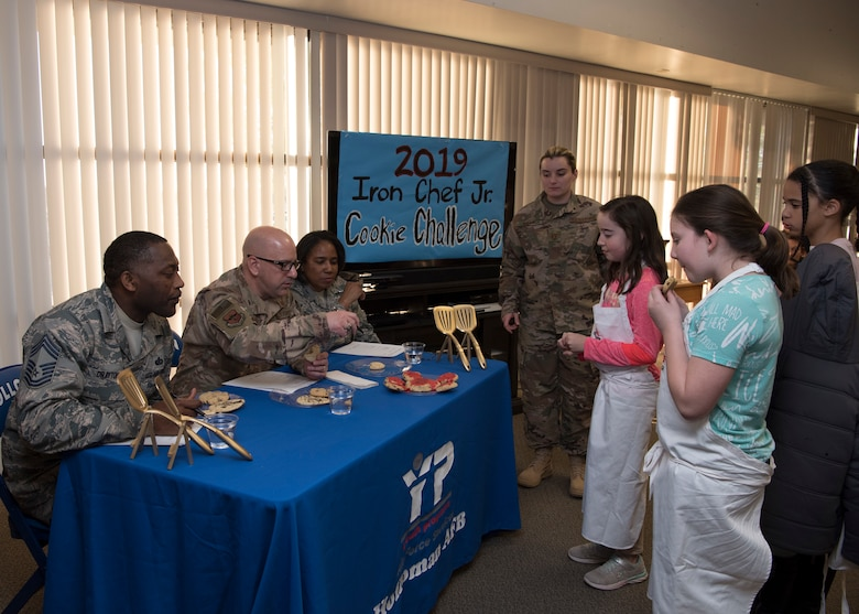 49th Mission Support Group leadership judges team Chipies' cookies, Jan. 30, 2019, on Holloman Air Force Base, N.M. Five teams from the Youth and Teen Center participated in a cookie baking challenge to win golden spatulas. (U.S. Air Force photo by Airman Autumn Vogt)