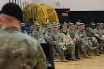7th Infantry Division Commander Maj. Gen. Willard Burleson and America's First Corps Soldiers listen to a speech by Lt. Col. Derek Bothern, battalion commander of the newly activated Intelligence, Information, Cyber, Electronic Warfare and Space Detachment, during a ceremony Jan. 11, 2019, at Joint Base Lewis McChord, Washington. The ceremony marked the launch of the first-ever Intelligence, Information, Cyber, Electronic Warfare and Space Detachment in the U.S. Army. I2CEWS was designed to integrate cyber warfare, electronic warfare and space capabilities. (U.S. Army photo by Pvt. Caleb Minor)
