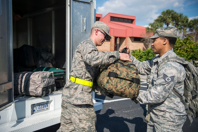 A 6th Logistics Readiness Squadron Airman assists a simulated deployer with their luggage during an operational readiness exercise at MacDill Air Force Base, Fla., Feb. 8, 2019. Total force Airmen from the 6th Air Mobility Wing and 927th Air Refueling Wing participated in the three-day exercise designed to emphasize the importance of combat skills effectiveness training and ensure Airmen are prepared for any potential contingencies.