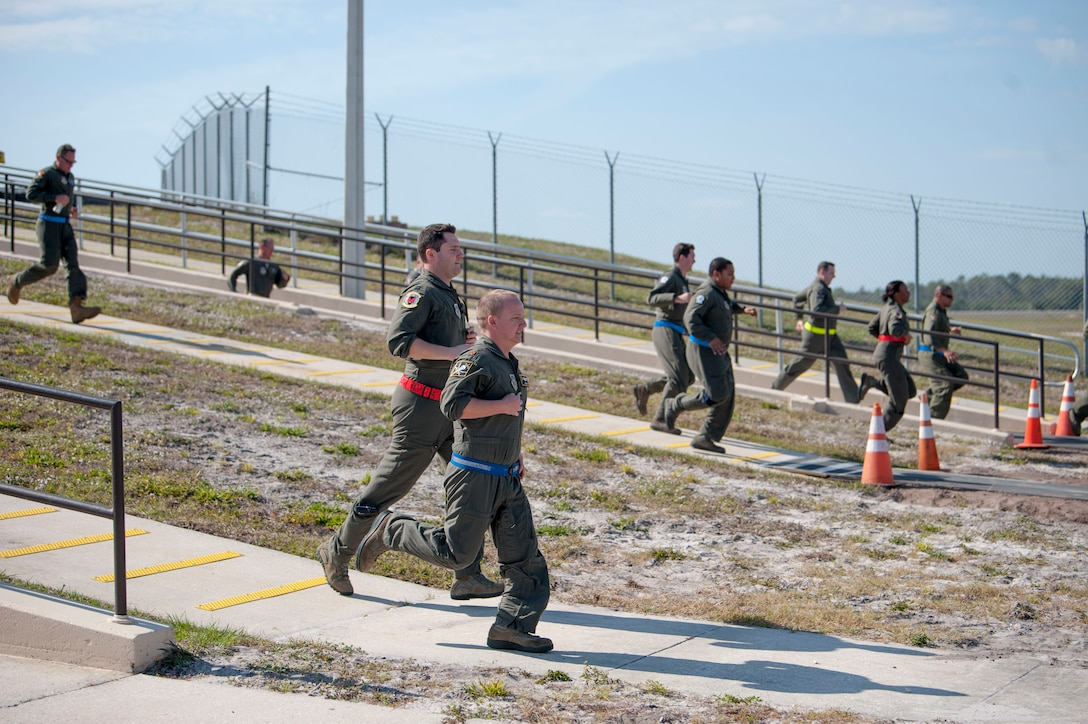 Aircrew members assigned to the 91st and 50th Air Refueling Squadrons sprint to their aircraft during an operational readiness exercise alert response at MacDill Air Force Base, Fla., Feb. 9, 2019. Total force Airmen from the 6th Air Mobility Wing and 927th Air Refueling Wing participated in a three-day readiness exercise designed to emphasize the importance of combat skills effectiveness training and ensure Airmen are prepared for any potential contingencies.