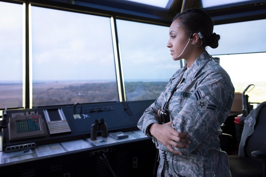 U.S. Air Force Airman 1st Class Sade Jelani, a 6th Operations Support Squadron air traffic controller, keeps an eye on the MacDill Air Force Base, Fla. flightline during a readiness exercise Feb. 10, 2019. Total force Airmen from the 6th Air Mobility Wing and 927th Air Refueling Wing participated in the three-day exercise, emphasizing the wing's contingency readiness.