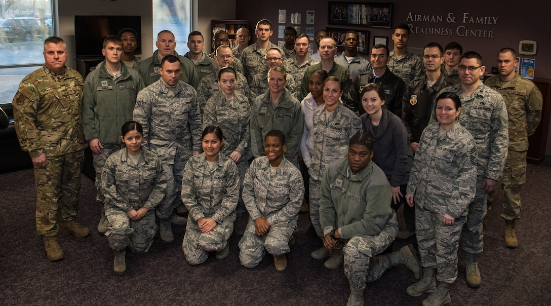 932nd Airlift Wing leadership, Col. Michael Cruff, commander, far left and Chief Master Sgt. Barbara Gilmore, command chief, front right pose with the newest citizen Airmen to join team Scott, Feb. 9, 2019, Scott Air Force Base, Illinois. With the January unit training assembly cancelled due to inclement whether conditions the February newcomers class was exceptionally large group. Leadership welcomes newcomers and gives a briefing about the 932nd AW mission, leadership, groups and answers questions each month.(U.S. Air Force photo by Master Sgt. Christopher Parr)