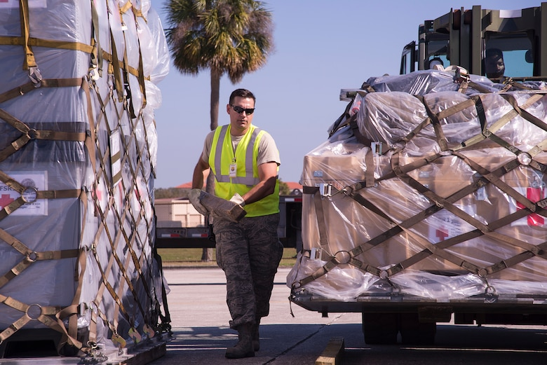 U.S. Air Force Master Sgt. Christopher Kotzur, 6th Logistics Readiness Squadron (LRS) personal property superintendent, moves dunnage under the lifted cargo during an operational readiness exercise Feb. 8, 2019 at MacDill Air Force Base, Fla. Airmen from the 6th LRS ensure cargo is packed safely, weighed and logged before deploying the equipment pallets with their respective units, highlighting the units capability to support contingency operations. (U.S. Air Force photo by Senior Airman Heather Fejerang)
