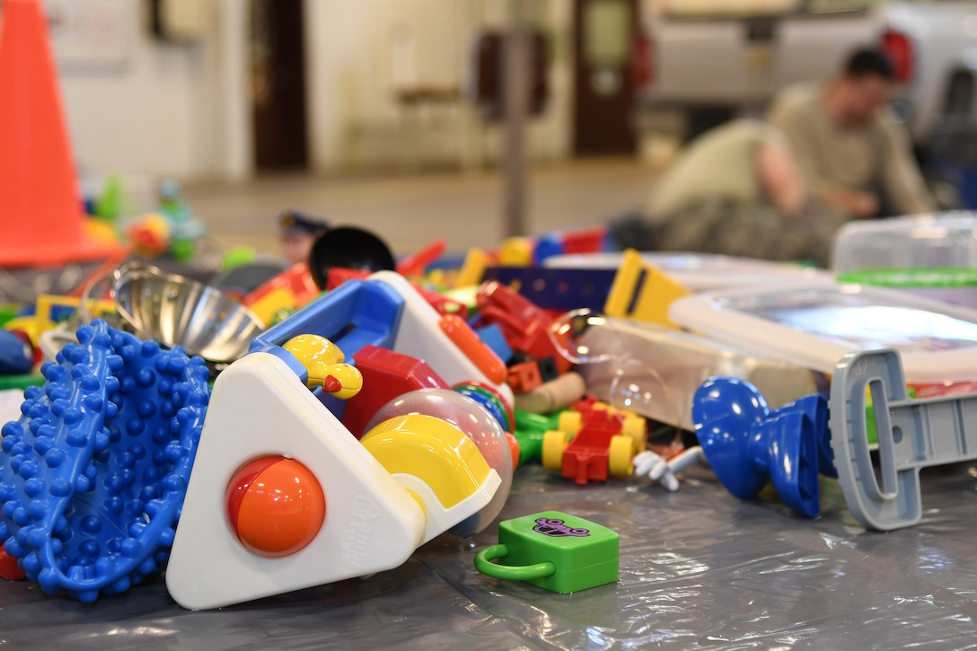 Toys air-dry after going through a sanitation process to include a bleach-solution soak, soapy water scrub, and final rinse January 18, 2019, on Grand Forks Air Force Base, North Dakota. More than 20 Airmen with the 319th Logistics Readiness Squadron worked transferring toys between each station, scrubbing toys of all sizes and ensuring each nook and cranny was dry prior to being returned to their origins- the base Child Development Center and Youth Programs. The toys needed to be cleaned after several Grand Forks AFB family members and personnel came down with a highly-contagious gastrointestinal virus, which spread to the CDC and other high-traffic areas. (U.S. Air Force photo by Senior Airman Elora J. Martinez)