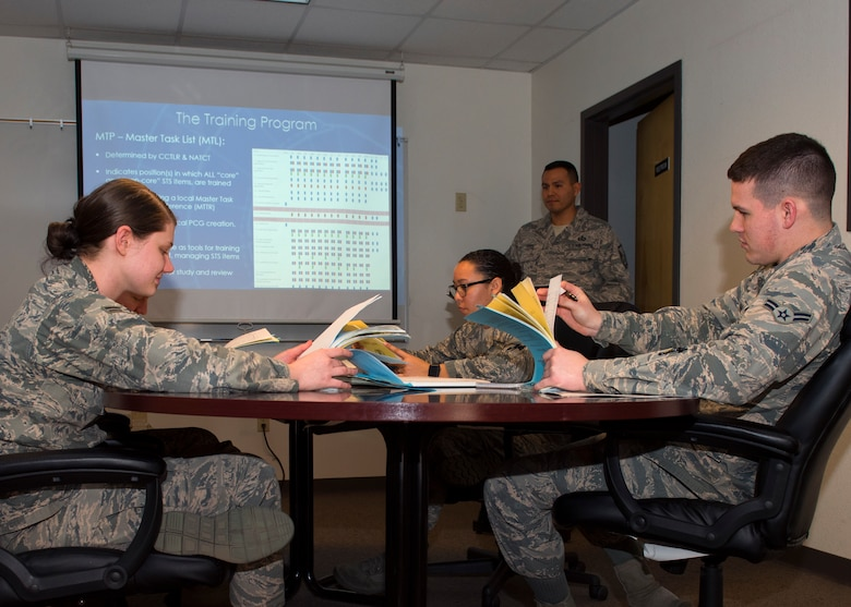 Airmen assigned to the 56th Operations Support Squadron air traffic control tower study training course material at Luke Air Force Base, Ariz., Feb. 7, 2019.