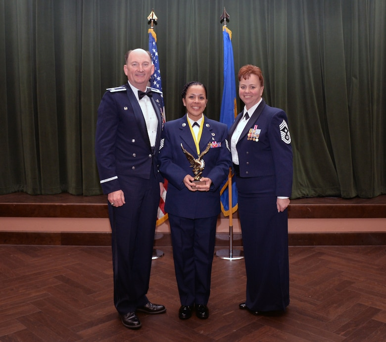 Col. Thomas K. Smith, 433rd Airlift Wing commander, and 433rd AW Command Chief Master Sgt. Shana C. Cullum, award Stephanie Sanchez, 433rd AW Safety Office, as the Civilian Category II of the Year at the 433rd AW annual awards banquet at Joint Base San Antonio-Lackland, Texas Feb. 9, 2019.