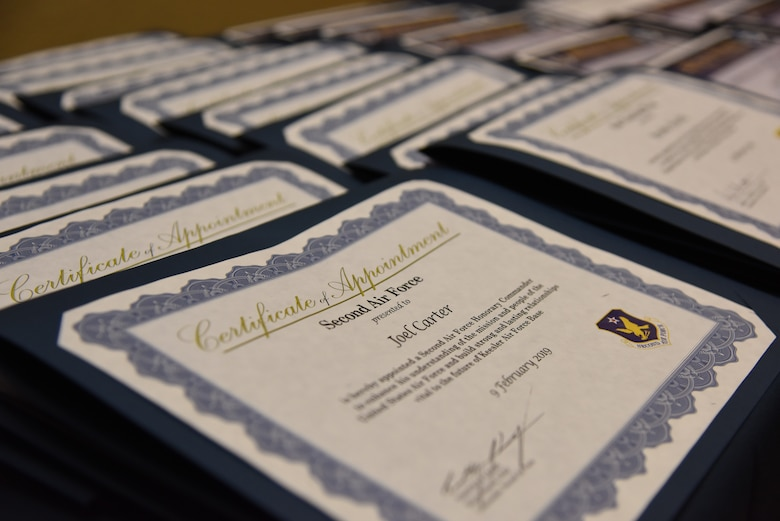 Certificates are displayed during the 2019 Honorary Commander Induction Ceremony inside the Bay Breeze Event Center at Keesler Air Force Base, Mississippi, Feb. 9, 2019. The event recognized the newest members of Keesler's honorary commander program, which is a partnership between military commanders and local civic and business leaders in order to enrich and strengthen the relationship between the base and the community. This was the first time leadership from the 2nd Air Force, 81st Training Wing and 403rd Wing combined to host a single joint induction ceremony. (U.S. Air Force photo by Kemberly Groue)