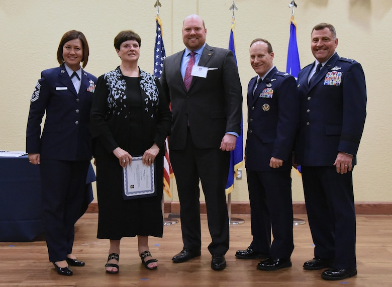 Leadership from 2nd Air Force pose for a group photo with the newly inducted honorary commanders during the 2019 Honorary Commander Induction Ceremony inside the Bay Breeze Event Center at Keesler Air Force Base, Mississippi, Feb. 9, 2019. The event recognized the newest members of Keesler's honorary commander program, which is a partnership between military commanders and local civic and business leaders in order to enrich and strengthen the relationship between the base and the community. This was the first time leadership from the 2nd Air Force, 81st Training Wing and 403rd Wing combined to host a single joint induction ceremony. (U.S. Air Force photo by Kemberly Groue)