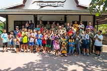 190209-N-DX072-1387 CHONBURI, Thailand (Feb. 9, 2019) – Sailors and Marines assigned to the amphibious transport dock ship USS Green Bay (LPD 20) pose for a group photos during a community service project at the Child Protection and Development Center in Chonburi, Thailand. Green Bay, part of the Wasp Amphibious Ready Group, with embarked 31st Marine Expeditionary Unit (MEU), is in Thailand to participate in Exercise Cobra Gold 2019. Cobra Gold is a multinational exercise co-sponsored by Thailand and the United States that is designed to advance regional security and effective response to crisis contingencies through a robust multinational force to address common goals and security commitments in the Indo-Pacific region.