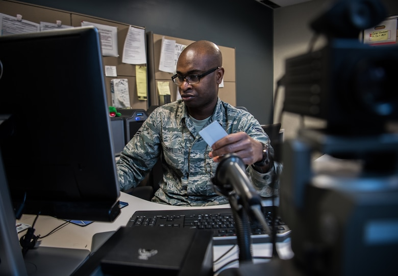 Airman First Class Nestor Biayi, personalist with the 932nd Force Support Squadron, prepares a blank identification card to be created Feb. 8, 2019, Scott Air Force Base, Illinois. Biayi joined the Air Force Reserve to both serve his country, but utilize the great educational benefits while serving. (U.S. Air Force photo by Christopher Parr)