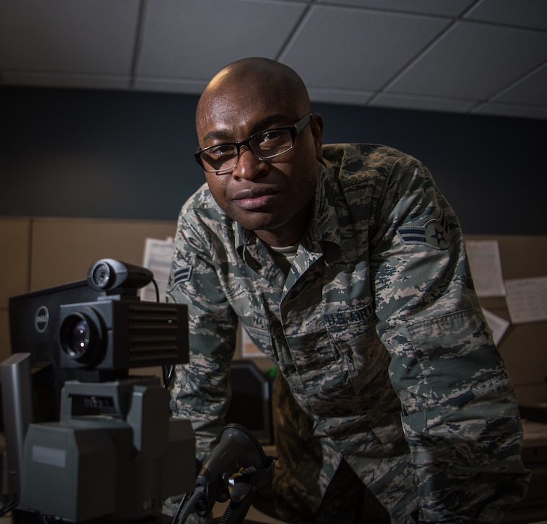 Airman First Class Nestor Biayi, personalist with the 932nd Force Support Squadron, poses for a portrait, Feb. 8, 2019, 932nd Airlift Wing Headquarters, Scott Air Force Base, Illinois. Biayi works in customer service helping to update records and issue IDs. (U.S. Air Force photo by Christopher Parr)