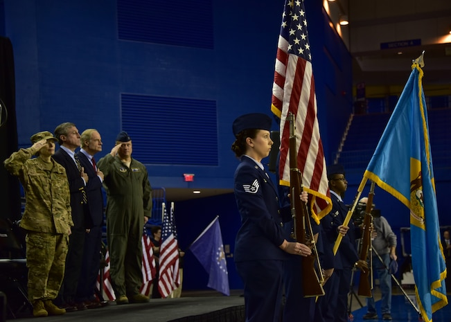 Leadership from the state of Delaware stand for the playing of the National Anthem at the University of Delaware's Bob Carpenter Center in Newark, Del., Feb. 10, 2019. Governor John Carney, the Adjutant General, Air Force Maj. Gen. Carol Timmons, the senior senator from the state, Tom Carper and wing commander, Col. Lynn Robinson were in attendance for the event. (U.S. Air National Guard photo by Senior Airman Katherine Miller)