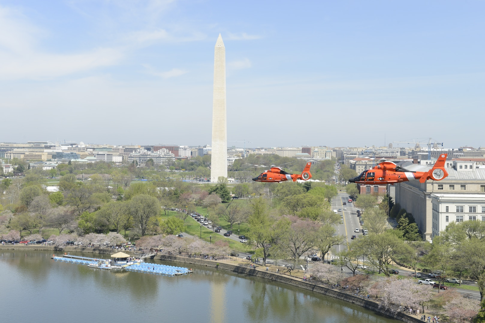 An MH-65 Dolphin helicopter crew from Coast Guard Air Station Atlantic City, N.J., flies over Washington on a training flight Thursday, April 16, 2015. Aircrews from Coast Guard Air Station Atlantic City train to stay proficient for the Rotary Wing Air Intercept mission over the nation's capital and other critical areas throughout the country. (U.S. Coast Guard photo by Petty Officer 3rd Class David Micallef)