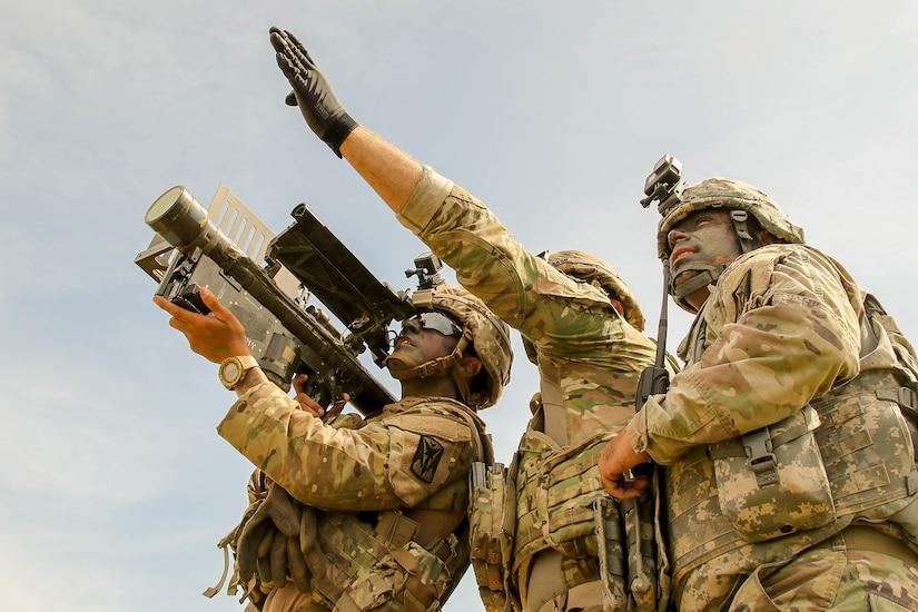 Man points missile launcher upward