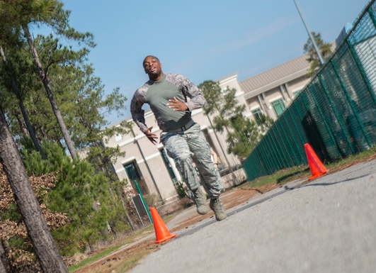 U.S. Air Force Senior Airman Jeremy Ashley, 20th Security Forces Squadron installation patrolman, sprints across the finish line at Shaw Air Force Base, S.C., Feb. 6, 2019.