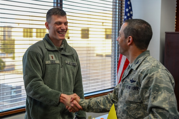 """Second Lt. Zachary Diehl, 47th Operations Support Squadron airfield operations officer, was chosen by wing leadership to be the """"XLer"""" of the week, for the week of Jan. 30, 2019, at Laughlin Air Force Base, Texas. The """"XLer"""" award, presented by Col. Lee Gentile, 47th Flying Training Wing commander, is given to those who consistently make outstanding contributions to their unit and the Laughlin mission. (U.S. Air Force photo by Senior Airman Benjamin N. Valmoja)"""