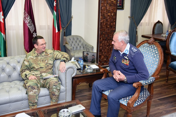 Two military generals sit and chat