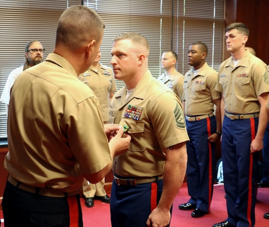 MILWAUKEE, Wisc. --- Gunnery Sgt. Pete Vargo, the staff noncommissioned officer-in-charge of Recruiting Substation Green Bay, was presented the Navy and Marine Corps Achievement Medal Thursday, August 2nd by Major Gen. James Bierman during a visit to Marine Corps Recruiting Station Milwaukee. Vargo was awarded the medal for his swift response and assistance at a vehicle crash on I-41 in Washington County that left seven injured and took the life of an 18-year-old.