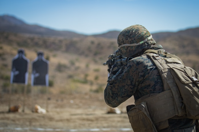 U.S. Marine Corps Lance Cpl. Everett Libolt, a missile gunner with 1st Tank Battalion, fires a M16 rifle during the live fire portion of the 1st Marine Division (MARDIV) Super Squad Competition at Marine Corps Base Camp Pendleton, California, Aug. 30, 2018.