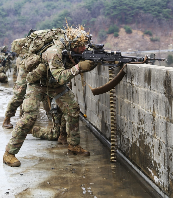Soldiers use suppressing fire during a force-on-force exercise.