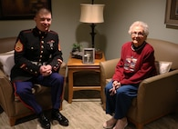 CEDARBURG, Wisc --- Staff Sgt. Nicholas Ranum, a Marine Corps Recruiting Station Milwaukee Marketing and Communications Marine, visited Ruth Voight-Holman, a Marine World War II Veteran, at Lasata Senior Living Campus in Cedarburg, Wisconsin, on Wednesday, January 23rd. He talked with her and bonded over their time in the Marines.